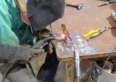 Andrew welding his bird to base