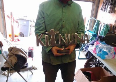 Enterprising Andrew creating 'Kitnuna' logo stand for potential sale...SOLD
