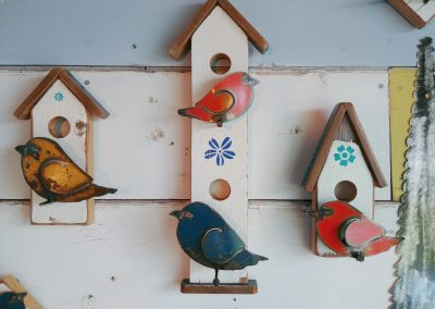 Recycled lumber birdhouses with metal birds